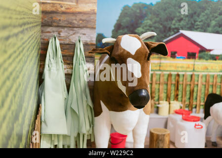 children's toy farm. Toy sheep, pig, cow large on a farm - Stock Photo