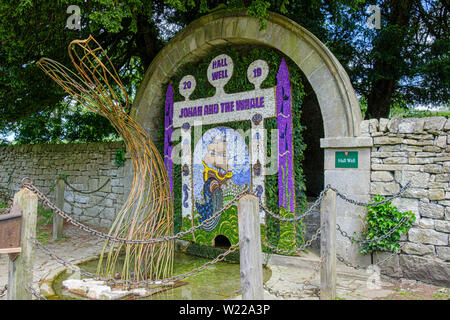 Well dressing is an annual Whitsuntide tradition dating back hundreds of years and closely associated with Tissington and the Derbyshire Peak District - Stock Photo