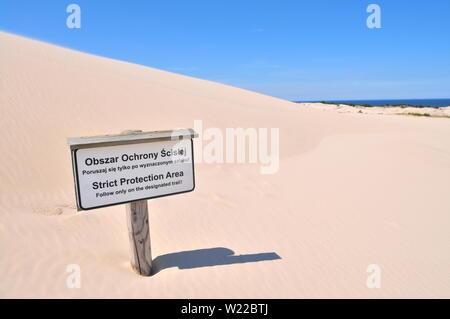 Strict Protection Area sign in Slowinski National Park, Leba, Poland Baltic Sea (Lacka dune) - Stock Photo