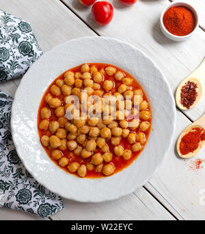 Vegetarian tasty spicy chick pea soup on a wooden background / Cheakpea stew/ Turkish nohut pilaki - Stock Photo