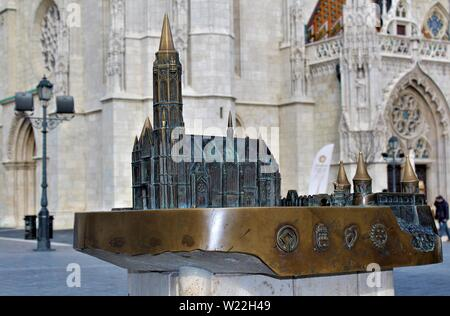 A bronze model of St Matthias church and Fishermans Bastion in Budapest, which is situated a short distance from the entrance to St Matthias church. - Stock Photo