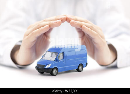 Transport blue van car protected by hands - Stock Photo