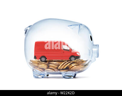 Transport red van car on coins inside transparent piggy bank with clipping path - Stock Photo