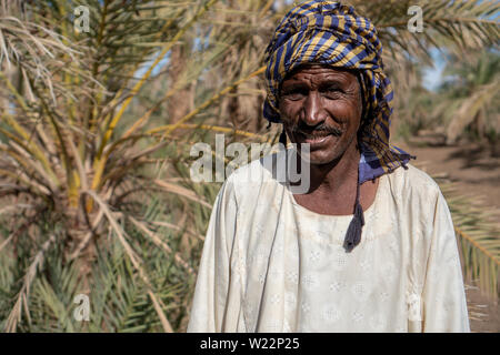 Portrait of a Nubian farmer wearing traditional clothes in northern Sudan, Nov 2018 - Stock Photo