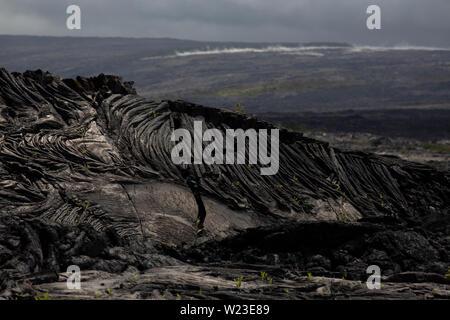 Field of pahoehoe lava rock on Kilauea volcano, Big Island, Hawaii - Stock Photo