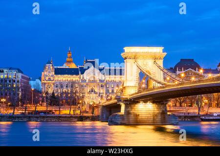 Chain Bridge Budapest Szechenyi Lanchid Gresham Palace Four Seasons Hotel Danube River Hungary - Stock Photo