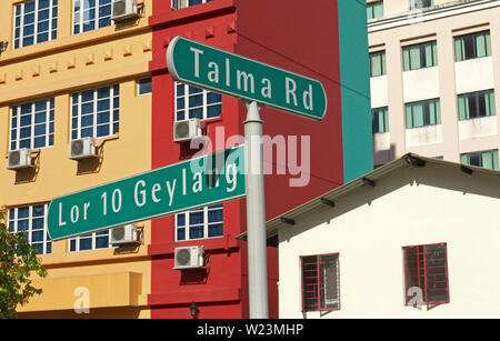 singapore, singapore - november 29, 2009: view onto facades of buildings in geylang and street sign - Stock Photo