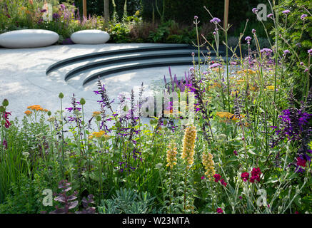 Digitalis ferruginea, Achillea terracotta and Salvia amistad in the Cancer Research UK Pledge Pathway to Progress Garden, at show garden at the Hampto - Stock Photo