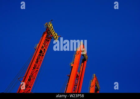 santos, sao paulo/brazil - february 08, 2014: the container crane jibs of tecon brasil container terminal rising into the sky - Stock Photo