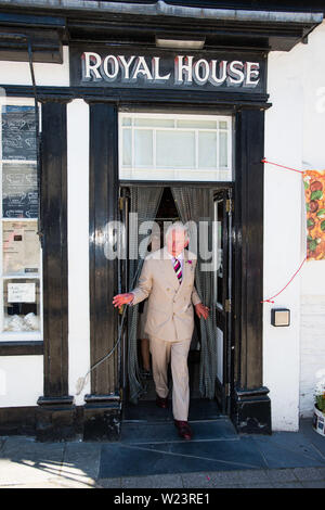 Machynlleth Powys Wales. July 05 2019  Prince Charoes emerges from the 'Royal House', an old shop in Machynlleth, now a bakery. on the final day of hois annual summer visit to Wales  pohoto credit: Keith Morris / Alamy Live News - Stock Photo