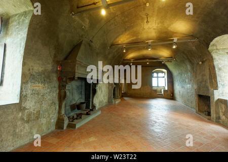 Empty hall with fireplaces in Castello di Serralunga d'Alba - Stock Photo