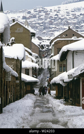 28th March 1993 During the Siege of Sarajevo: the view north along the narrow Gazi Husrev Begova and beyond to the steeply-rising Kaukcije Abdulah Efendije (renamed Logavina after the war) in the old town area. - Stock Photo