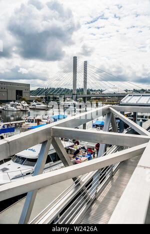 View from above the marina near the Museum of Glass in Tacoma, Washington.  The view includes the 21st Bridge, Marina, and the Tacoma Dome. - Stock Photo