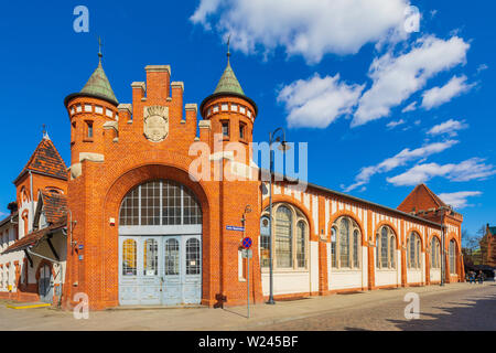 Bydgoszcz, Kujavian-Pomeranian / Poland - 2019/04/01: Front view of the historic Municipal Market Hall building at the Magdzinskiego street in the old - Stock Photo