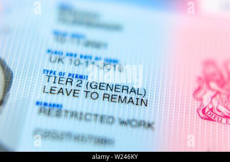 UK Tier 2 Visa BRP (Biometrical Residence Permit) card macro photo. - Stock Photo