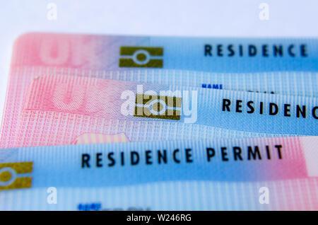 UK Tier 2 Visa BRP (Biometrical Residence Permit) cards - macro photo. - Stock Photo