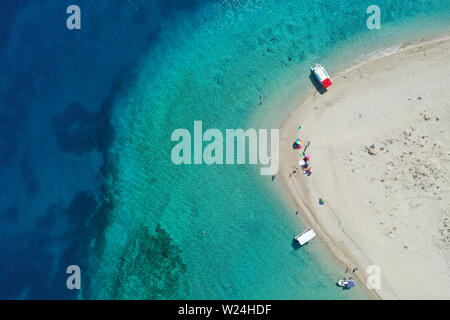 Aerial drone view of iconic small uninhabited island of Marathonisi featuring clear water, sandy shore and natural hatchery of Caretta-Caretta sea tur - Stock Photo