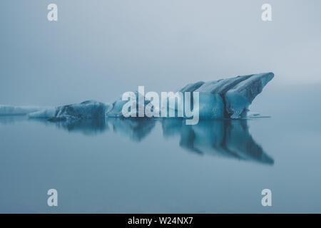 Iceland at midnight - melting icebergs from Jökulsárlón glacier - Stock Photo