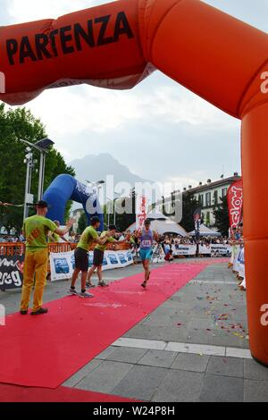 Lecco/Italy - June 1, 2013: Sportswoman arrived at the finish of the 'Lecco city - Resegone mountain' running marathon event. - Stock Photo
