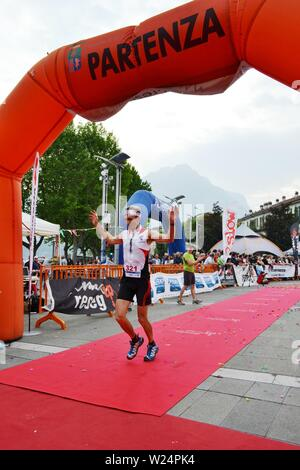 Lecco/Italy - June 1, 2013: Sportsman arrived at the finish of the 'Lecco city - Resegone mountain' running marathon event. - Stock Photo