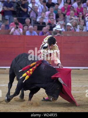 Spanish bullfighter Alvaro Lorenzo performs a pass on his second