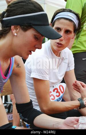 Lecco/Italy - June 1, 2013: Sportswomen arrived at the finish of the 'Lecco city - Resegone mountain' running marathon event. - Stock Photo