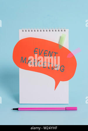 Conceptual hand writing showing Event Marketing. Concept meaning describes process of developing display to promote product Spiral notepad speech bubb - Stock Photo