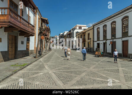 TEROR, GRAN CANARIA, SPAIN - MARCH 08, 2018: View of very cozy street in the historic center. Old houses, ominous from time , tourists and locals walk - Stock Photo