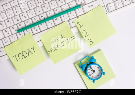 Writing note showing Value Proposition. Business concept for feature intended to make a company or product attractive - Stock Photo