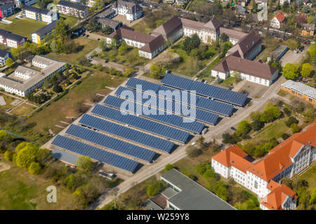Car parking covered with solar panels in Berlin suburb, Germany. Aerial view from above. - Stock Photo