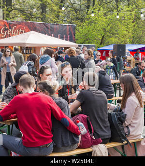 KYIV, UKRAINE - APRIL 21, 2019: People visit Food and Wine Festival in National Expocenter, a permanent multi-purpose exhibition complex. - Stock Photo