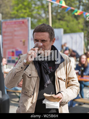 KYIV, UKRAINE - APRIL 21, 2019: People tasting wine during Food and Wine Festival in National Expocenter, a permanent multi-purpose exhibition complex - Stock Photo