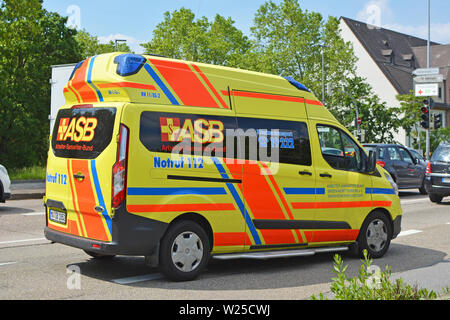 Yellow emergency car of ASB - the Workers' Samaritan Federation, a German aid and welfare organisation for civil protection, rescue service - Stock Photo