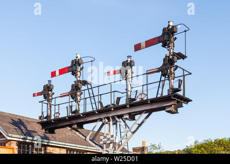 An historic semaphore signal in the stop / danger position on the North Yorkshire Moors Railway in the north of England. - Stock Photo