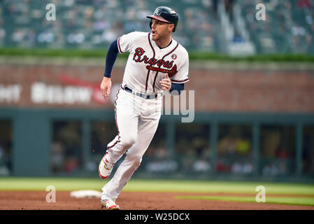 Atlanta, GA, USA. 04th July, 2019. Atlanta Braves first baseman Freddie Freeman looks towards left field as he heads to third base during the first inning of a MLB game against the Philadelphia Phillies at SunTrust Park in Atlanta, GA. Austin McAfee/CSM/Alamy Live News - Stock Photo