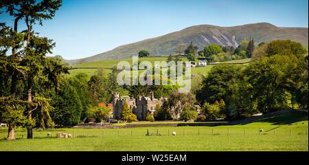 UK, Cumbria, Sedbergh, Marthwaite, Ingmire Hall , distant panoramic view from Hebblethwaites towards Winder and Howgill Fells - Stock Photo