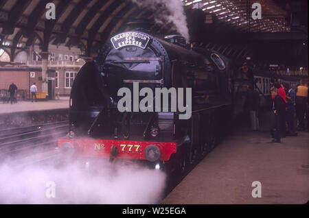 Scarborough spa express train hauled by ex Southern railway King Arthur class locomotive Sir Lamiel  waits to depart at York railway station - Stock Photo