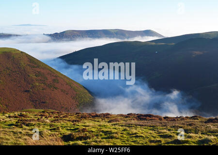 View of the Shropshire Hills from the Long Mynd, with clouds in the valley. Above the clouds, looking down. UK - Stock Photo