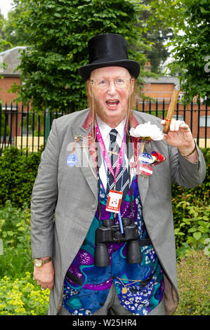 Royal Ascot, Ascot Racecourse, Berkshire, UK. 18th June, 2013. Racing pundit and journalist John McCririck wears a brightly coloured waistcoat and poses for photographs with his signature cigar at Royal Ascot. Credit: Maureen McLean/Alamy - Stock Photo