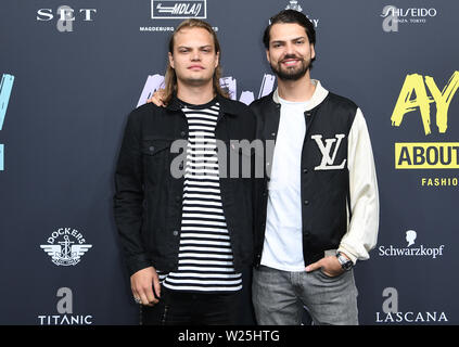Berlin, Germany. 05th July, 2019. Wilson Gonzalez Ochsenknecht (l) with his brother Jimi Blue Ochsenknecht come to the show 'About You'. The collections for Spring/Summer 2020 will be presented at Berlin Fashion Week. Credit: Britta Pedersen/dpa-Zentralbild/dpa/Alamy Live News - Stock Photo