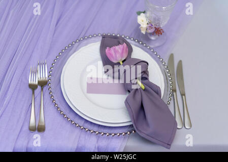 Card of the groom and festive table appointments for a lunch. - Stock Photo