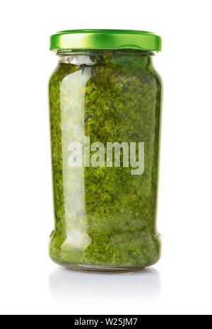 Glass jar of pesto sauce isolated on the - Stock Photo
