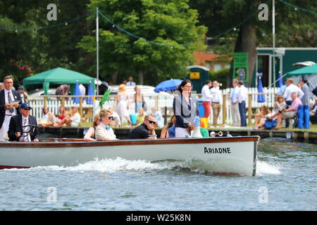 The Umpire boat follows the competitors at speed at Henley Royal Regatta, Henley-on-Thames, UK - Stock Photo
