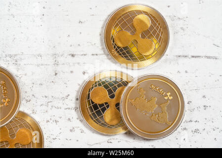 Top down view, golden XRP - ripple cryptocurrency - coins on white stone board - Stock Photo