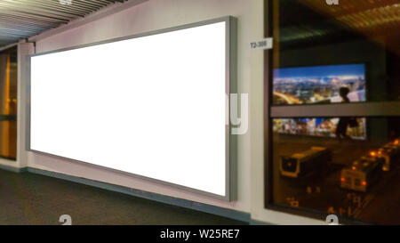 white blank billboard with copy space for your text message or content, advertising mock up banner at the airport, public information board with big w - Stock Photo