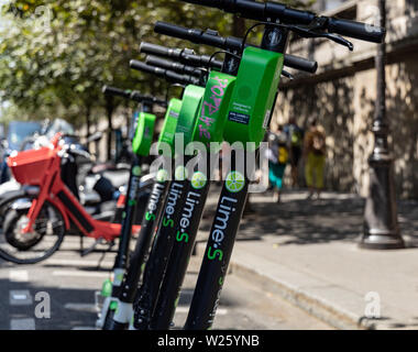 Paris, FRANCE - June 27, 2019: View of Lime electric scooters, rented through a mobile app and dropped off anywhere in the French capital near the - Stock Photo