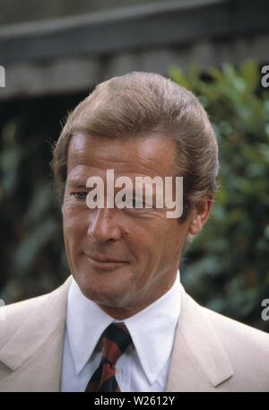 Outdoor portrait of actor Roger Moore. - Stock Photo