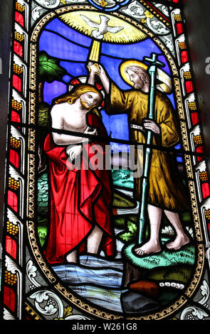 Detail from the stained glass window 'Scenes from the Life of Christ' depicting the Baptism of Jesus - Stock Photo