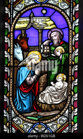 Detail from the stained glass window 'Scenes from the Life of Christ' depicting the Nativity - Stock Photo