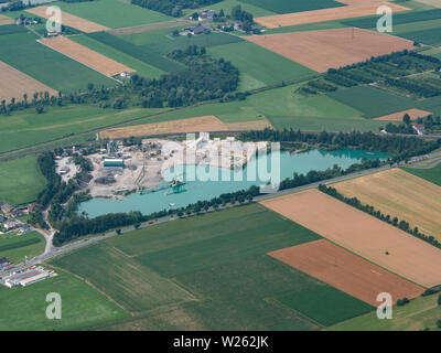 Gravel Pit with Pond - Aerial View - Commercial Gravel and Sand Quarry - Gravel Industry - Stock Photo